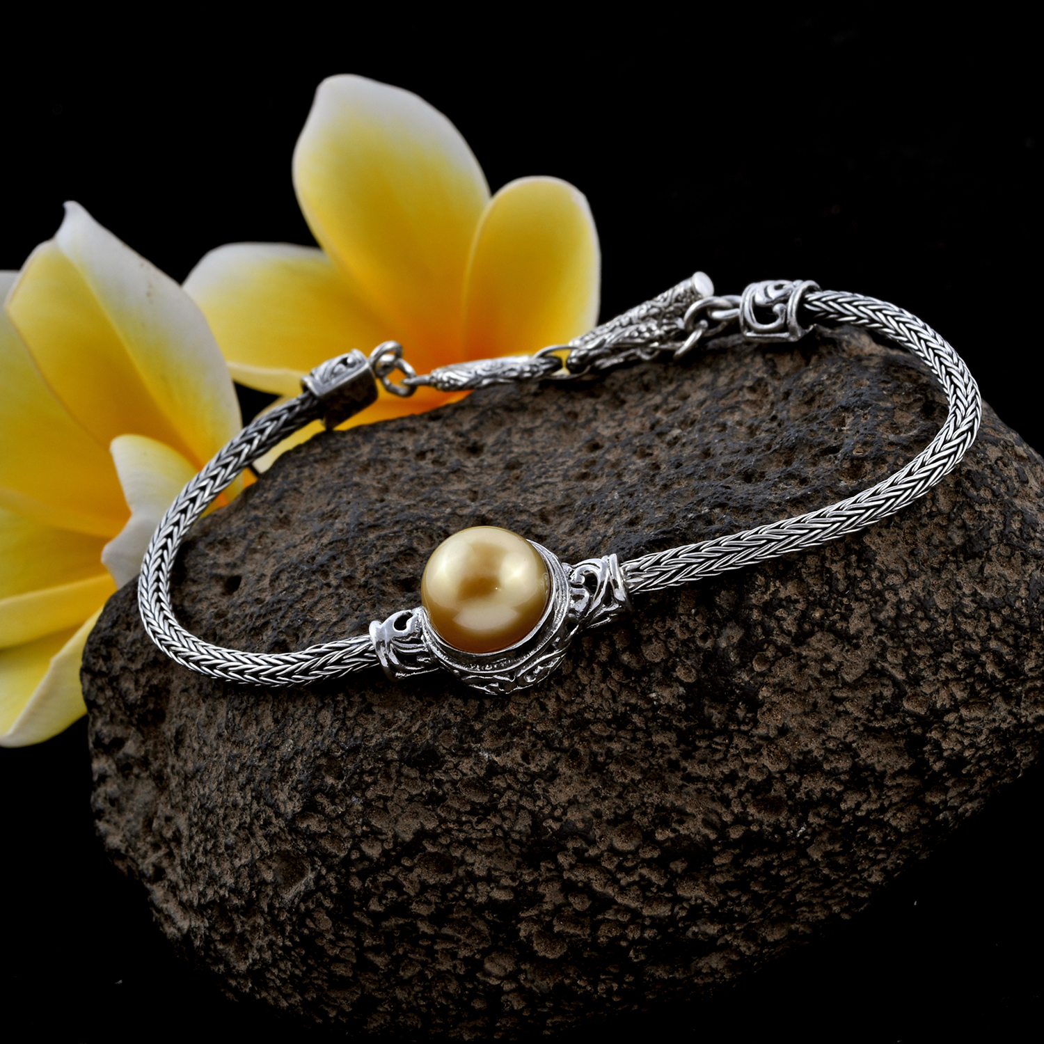 Bali silver bracelet featuring golden South Sea cultured pearl.