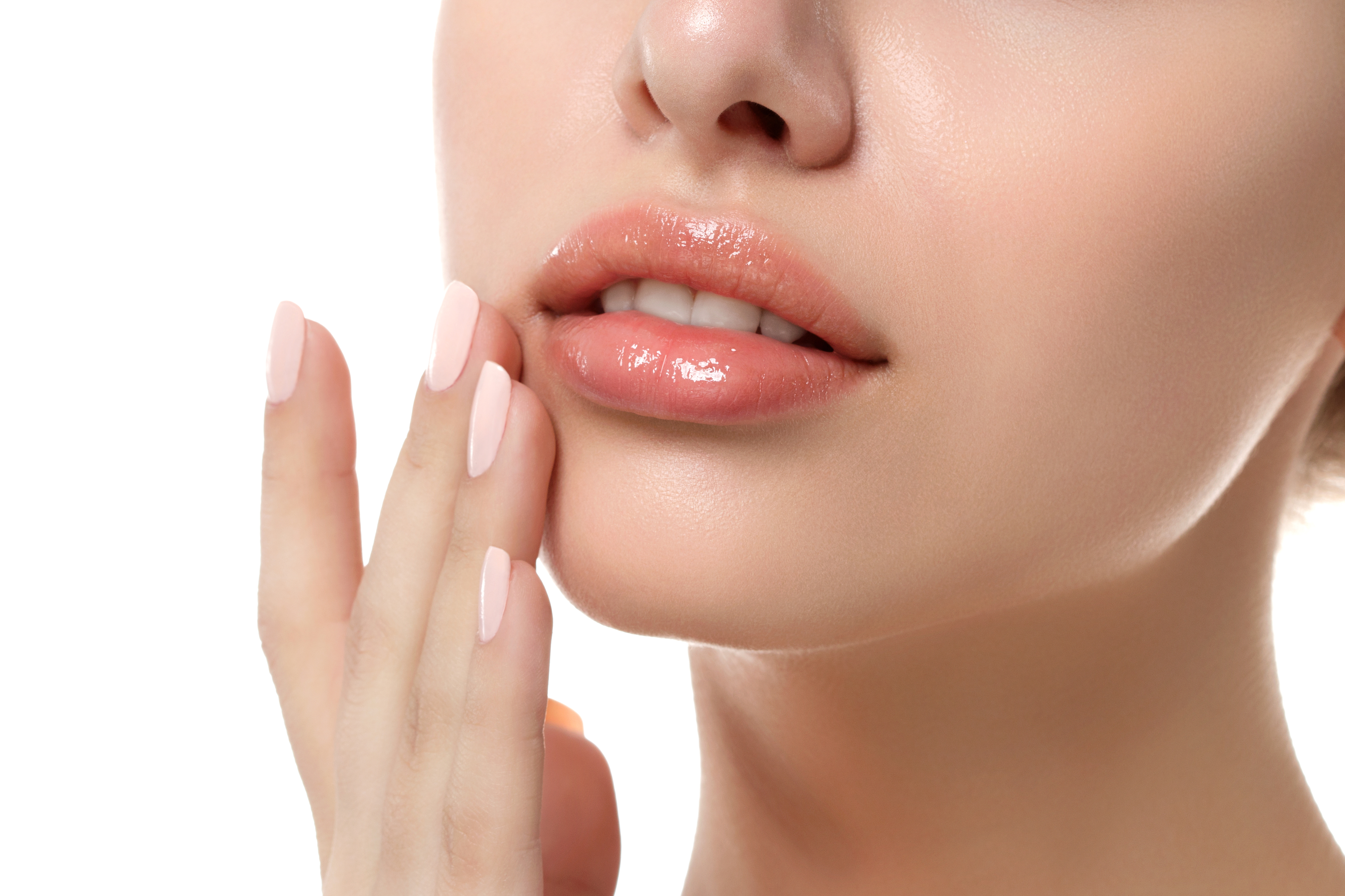 Woman exfoliating her lips.