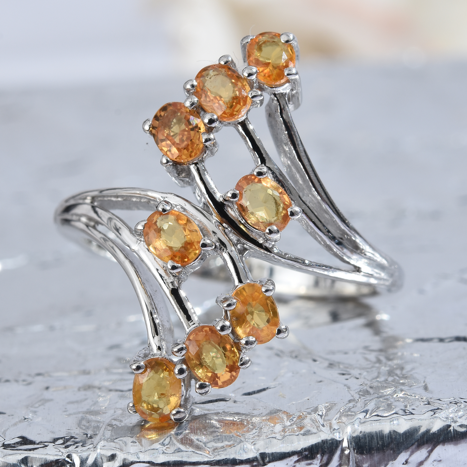 Orange sapphire bypass ring in sterling silver.