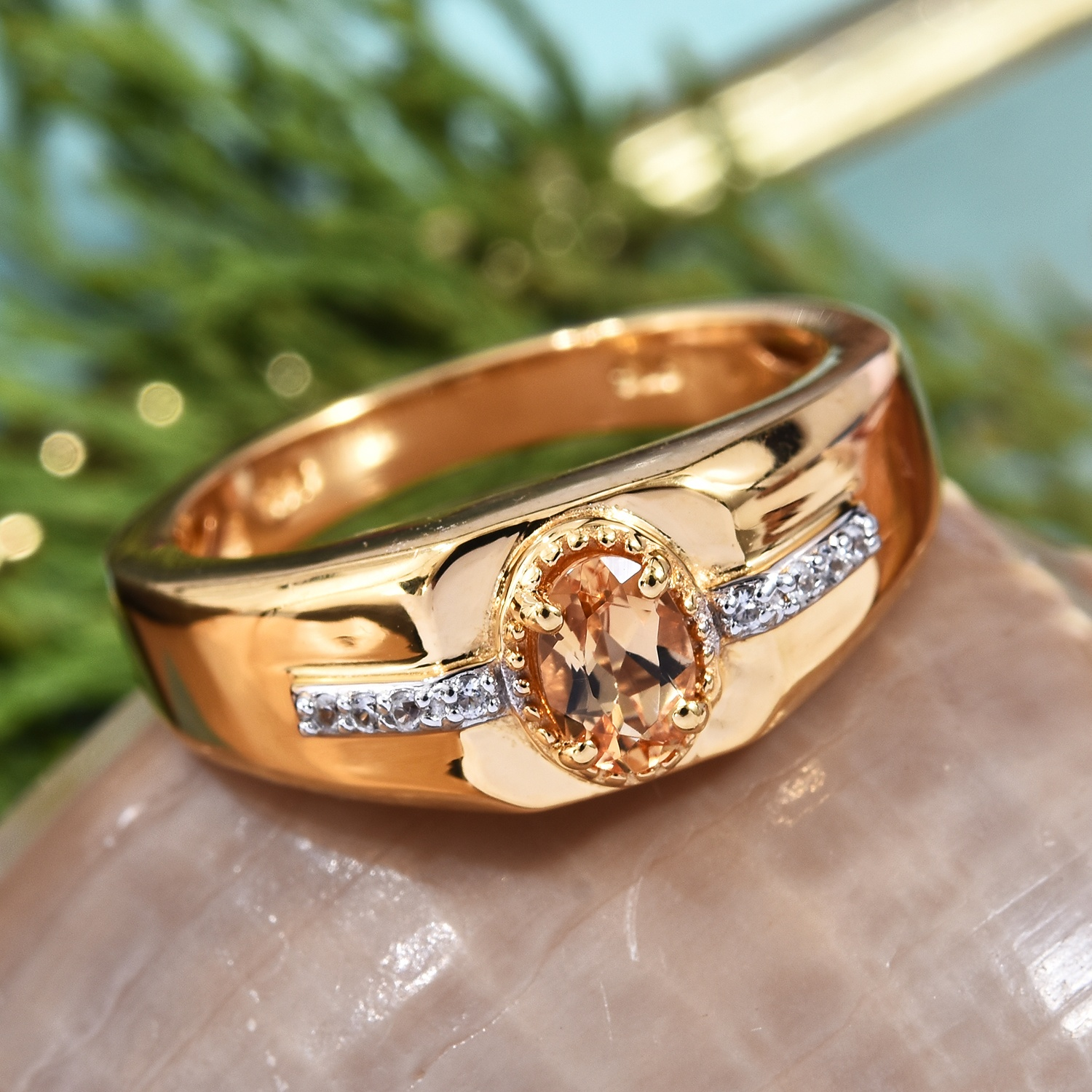 Gold men's ring featuring imperial topaz.