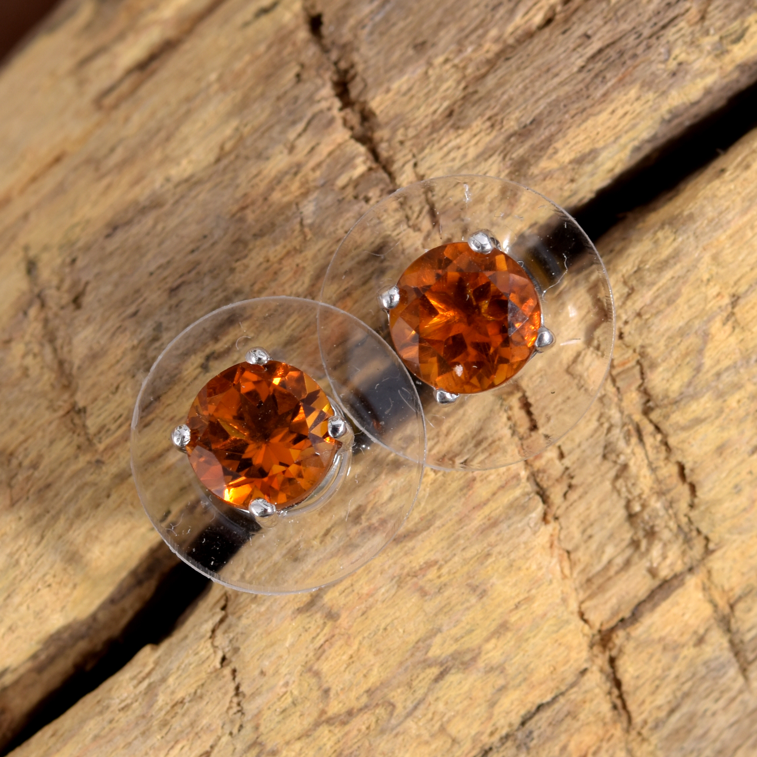 Orange citrine stud earrings with prong setting.