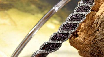 Purple diamond bangle bracelet displayed artfully.