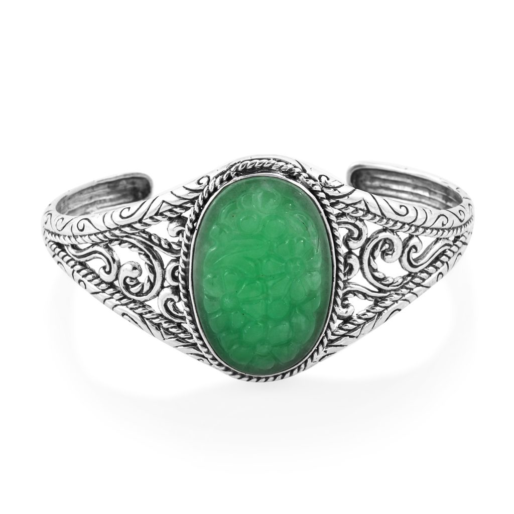 Burmese jade bangle on white background.