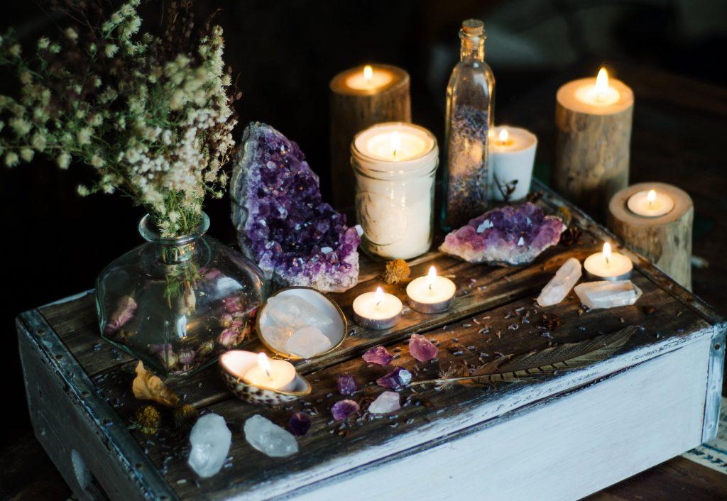Candles and gemstones arranged for meditation.