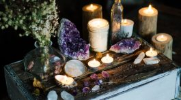 Candles and gemstones arranged for meditation.
