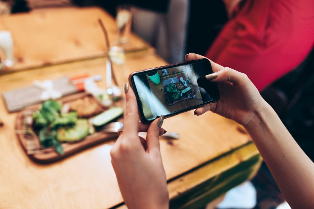 Woman photographing her lunch.
