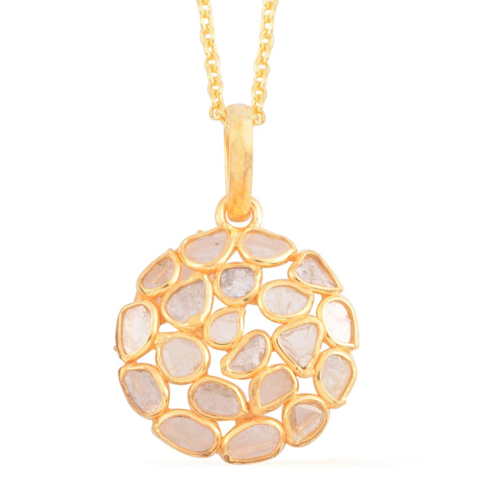 Polki diamond gold pendant on white background.