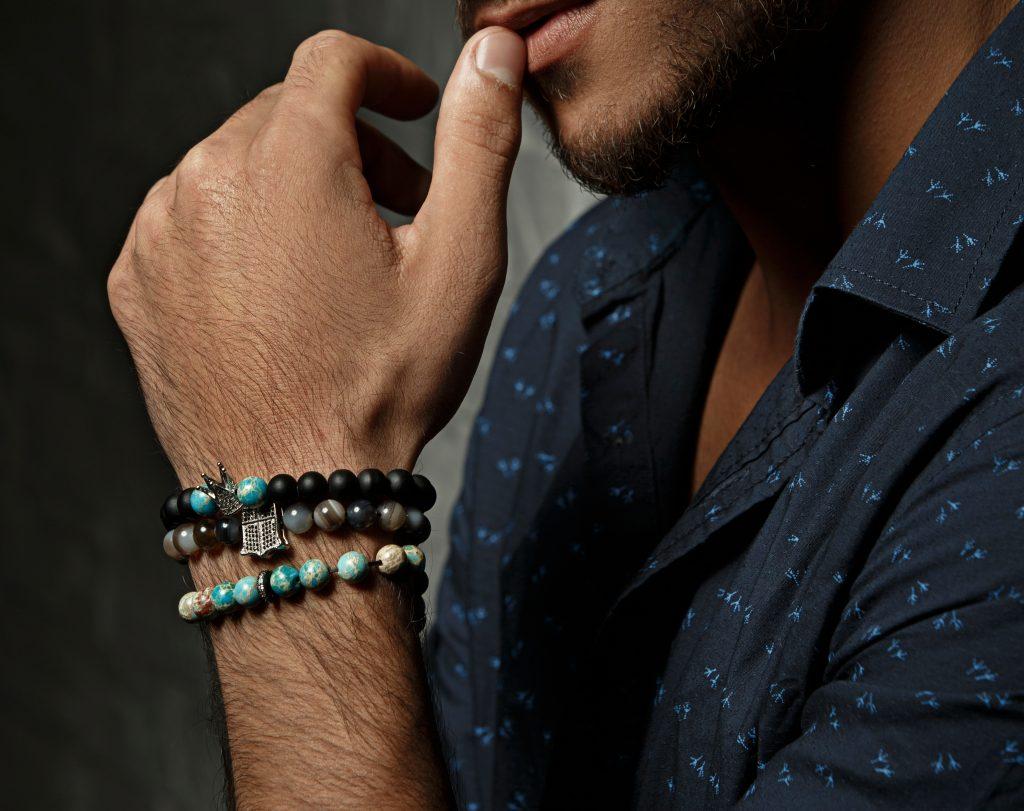 Close up of stacking men's bracelets.