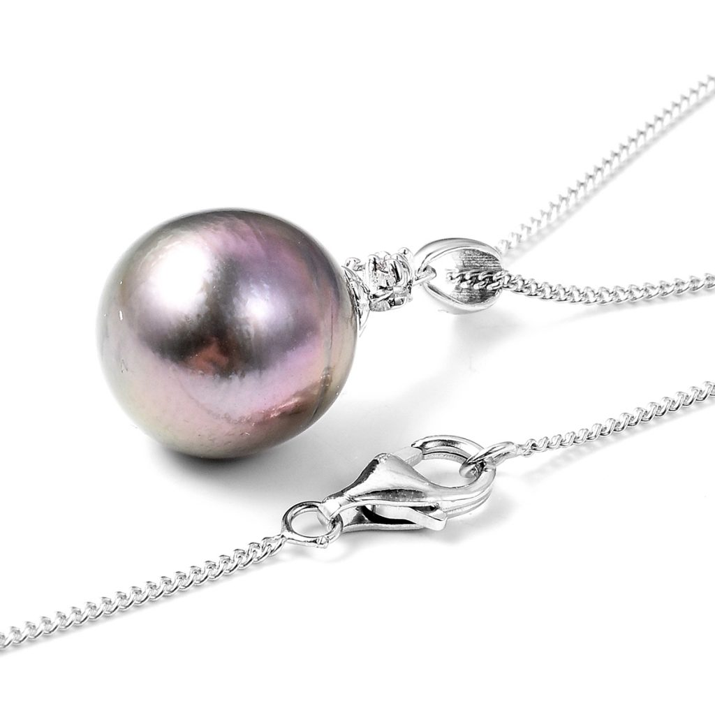 Tahitian pearl pendant necklace on white background.