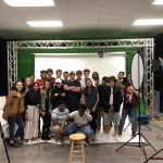 Round Rock High School students posing for a group photo at Shop LC.