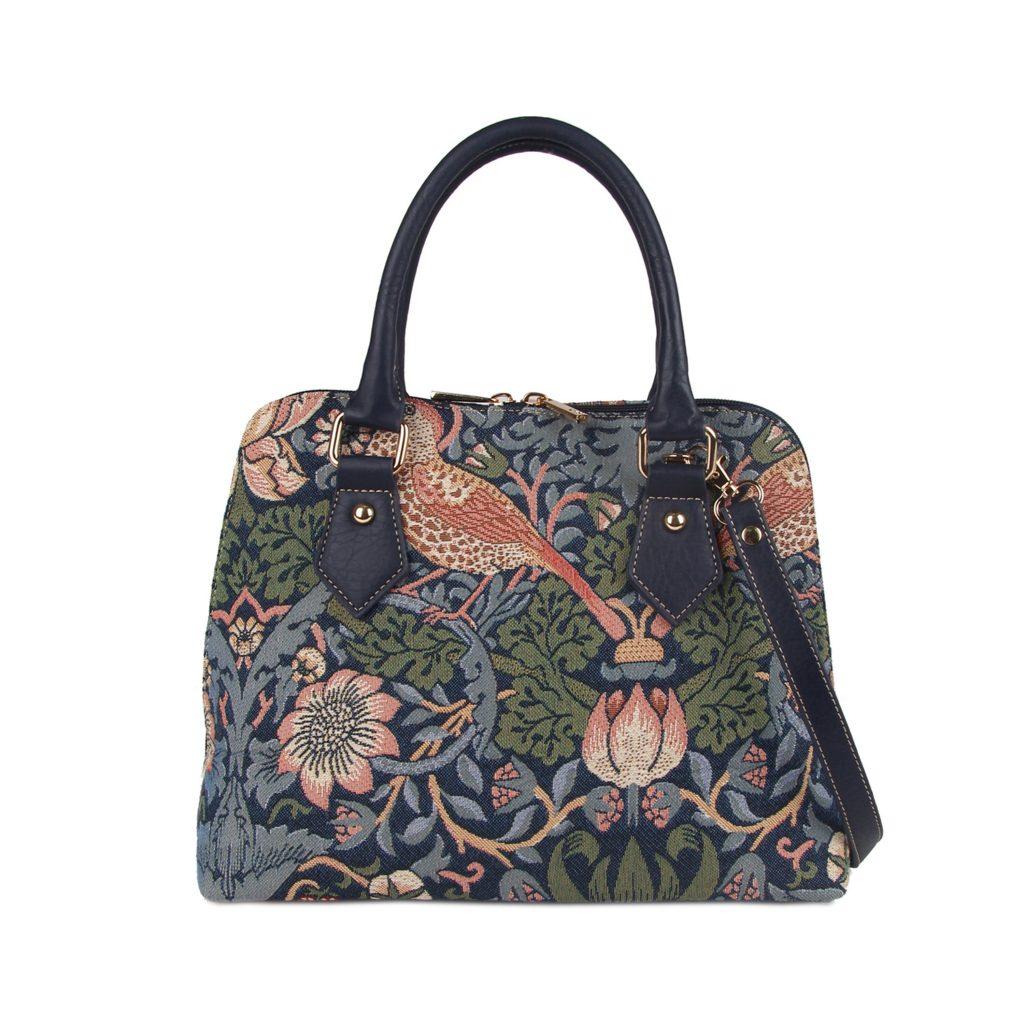 Convertible floral pattern Signare handbag.