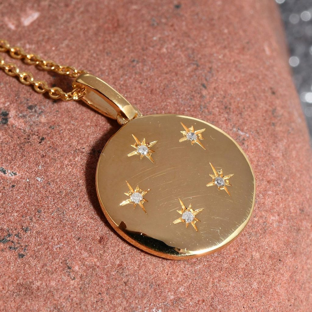 Star pendant in 10K yellow gold vermeil with diamond accents.