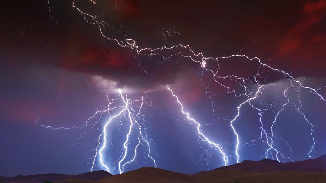 Lightning bolts streaking across the sky.
