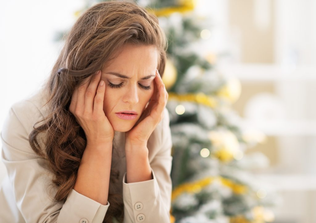 Woman trying to manage holiday stress.