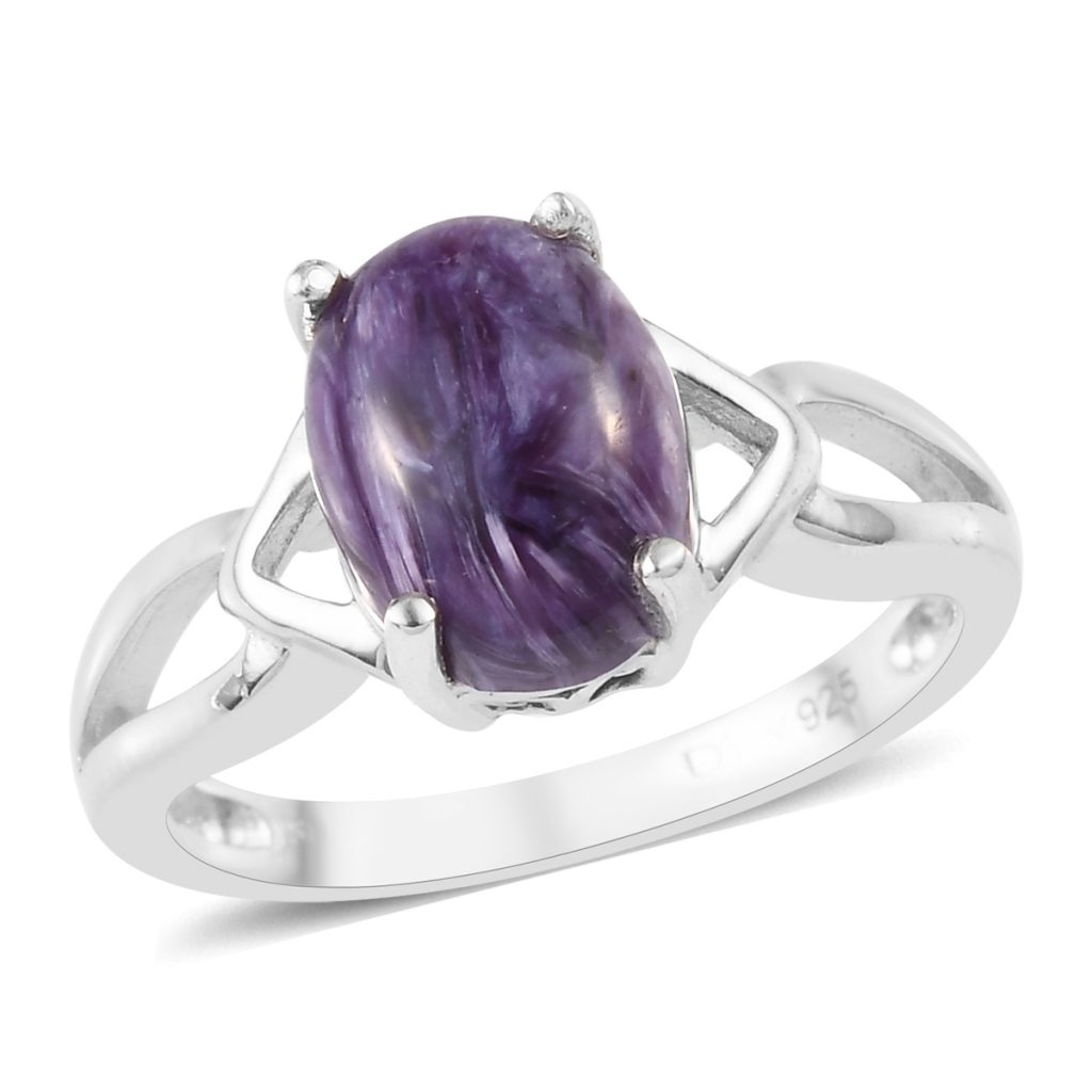 Charoite ring in sterling silver on white background.
