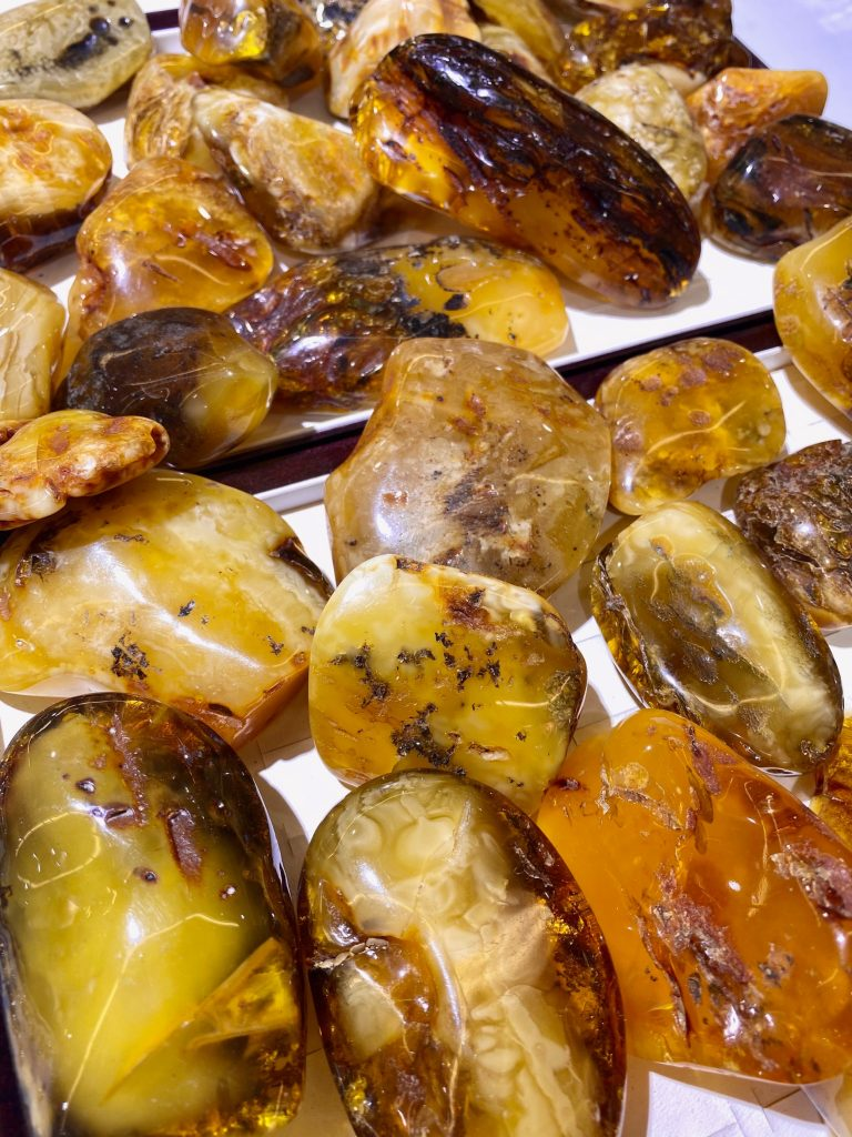 Assortment of amber stones on lighted surface.