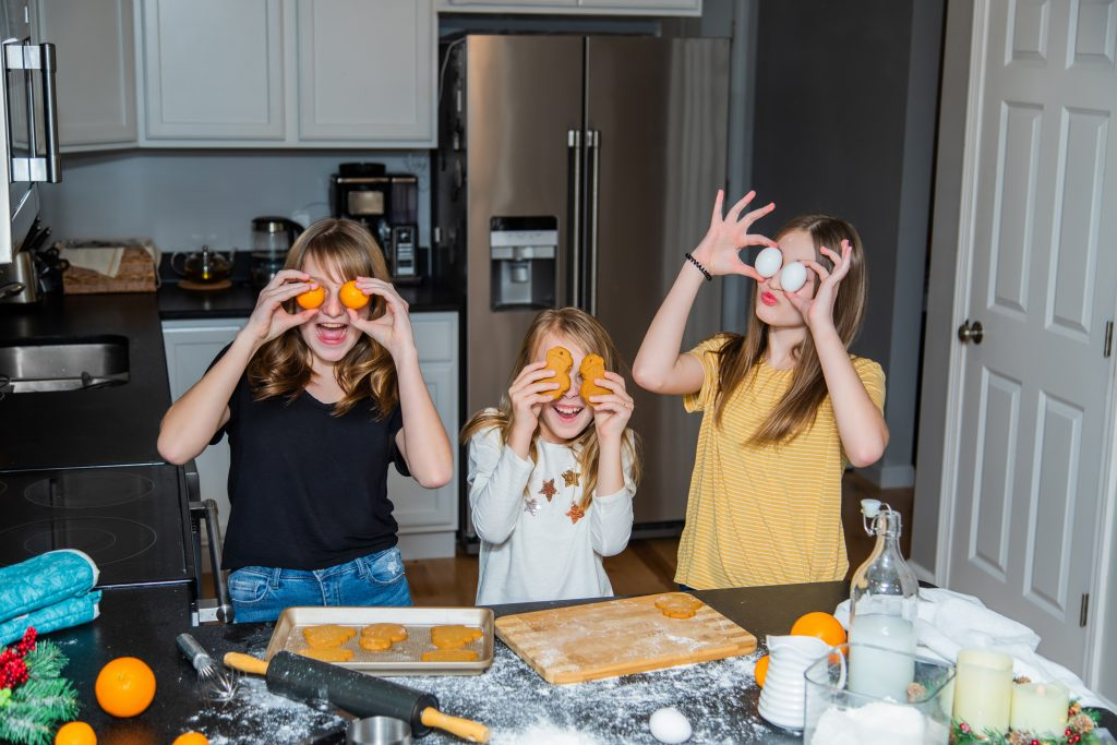 Girls having fun while cooking.