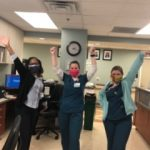 Healthcare workers at Houston Methodist receiving face masks.