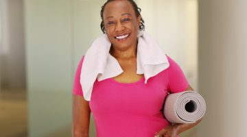 Elderly Black woman smiling after a workout.