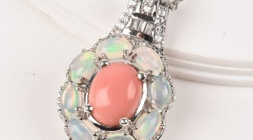 Peach opal pendant with halo of Welo opals in sterling silver.