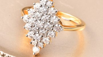 Moissanite cluster ring in 10K yellow gold.
